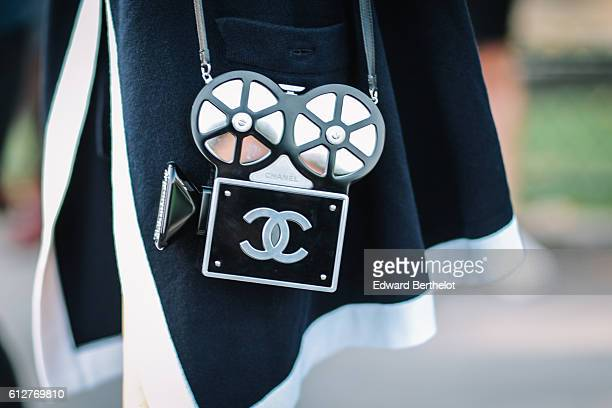 Guest is wearing a Chanel bag, outside the Chanel show, during Paris Fashion Week Spring Summer 2017, at Grand Palais, on October 4, 2016 in Paris,...