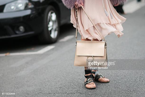 A guest is wearing a Chloe bag outside the Chloe show at Grand Palais during Paris Fashion Week Spring Summer 2017 on September 29 2016 in Paris...