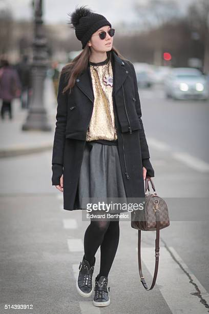 A guest is wearing a Louis Vuitton bag after the Chanel show during Paris Fashion Week Womenswear Fall Winter 2016/2017 on March 8 2016 in Paris...