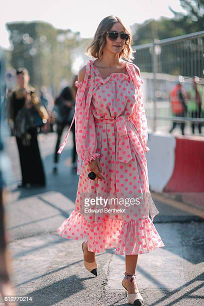 A guest is wearing a pink dress outside the Chanel show during Paris Fashion Week Spring Summer 2017 at Grand Palais on October 4 2016 in Paris France