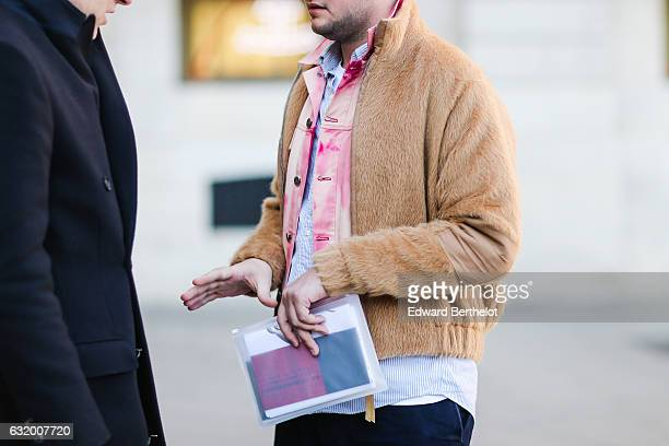 A guest is wearing a pink shirt and a camel faux fur coat after the Balenciaga show during Paris Fashion Week Menswear Fall/Winter 2017/2018 at Place...