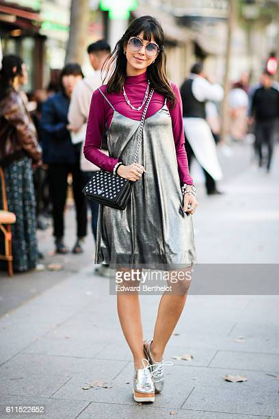 A guest is wearing a Prada bag outside the Balmain show during Paris Fashion Week Spring Summer 2017 on September 29 2016 in Paris France