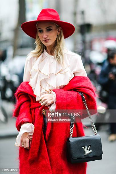 Guest is wearing a red hat, a pink top, a red coat, and a Vuitton bag, outside the Elie Saab show, during Paris Fashion Week Haute Couture Spring...