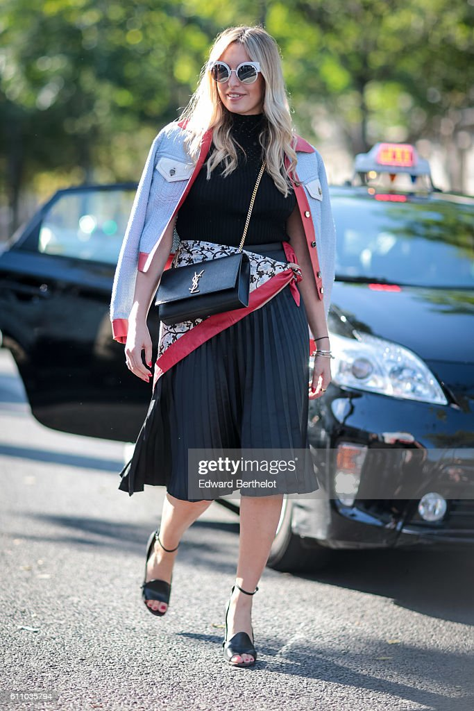 A guest is wearing a Saint Laurent YSL bag, outside the Rochas show, at the Palais de Tokyo, during Paris Fashion Week Spring Summer 2017, on September 28, 2016 in Paris, France.