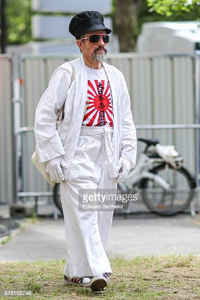 Guest is wearing a white kimono, before the Dior show, during Paris Fashion Week Menswear Spring/summer 2017, on June 25, 2016 in Paris, France.