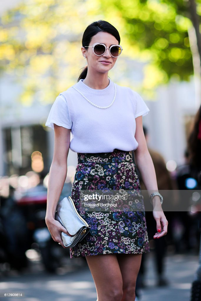 A guest is wearing a white top and a colored skirt, outside the Miu Miu show, during Paris Fashion Week Spring Summer 2017, on October 5, 2016 in Paris, France.
