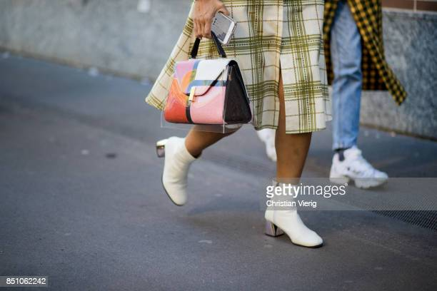 A guest is wearing bag is seen outside Fendi during Milan Fashion Week Spring/Summer 2018 on September 21 2017 in Milan Italy