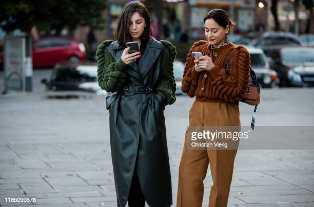 A guest is wearing brown knit and a guest wearing green leather coat with knitted sleeves seen during day 3 of the MercedesBenz Tbilisi Fashion Week...