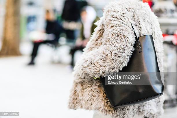 A guest is wearing fluffy white faux fur coat after the Louis Vuitton show during Paris Fashion Week Menswear Fall/Winter 2017/2018 outside the...