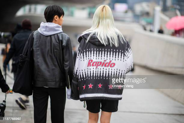 A guest is wearing jacket with print Rapido seen at the Hera Seoul Fashion Week 2019 F/W at Dongdaemun Design Plaza at Dongdaemun Design Plaza on...