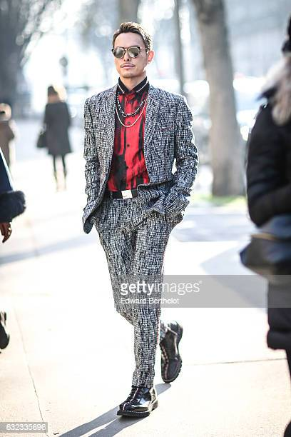 A guest is wearing sunglasses a red shirt and a suit outside the Dior show at the Grand Palais during Paris Fashion Week Menswear Fall/Winter...