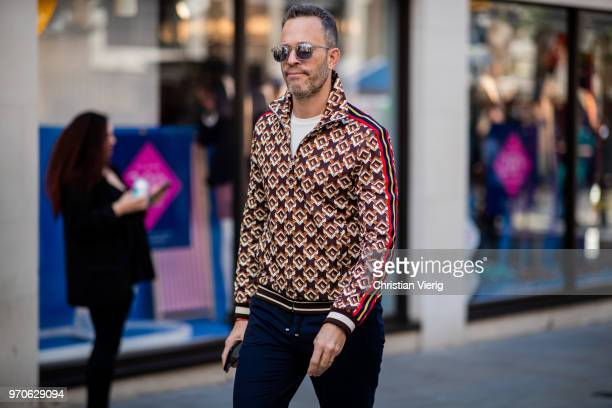 A guest is wearing zipped jacket seen during London Fashion Week Men's June 2018 on June 9 2018 in London England