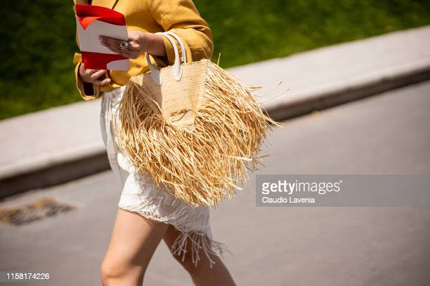 Guest, Jacquemus bag details, is seen outside Kenzo fashion show on Day 6 during the Paris Fashion Week Spring/Summer 202> on June 23, 2019 in Paris,...