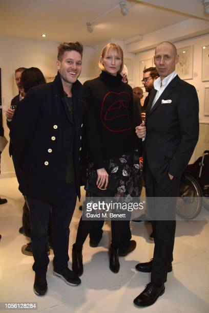 Guest Jade Parfitt and Nick Knight attend a private view of '100 Women' an exhibition of fashion illustration to celebrate the centenary of women's...
