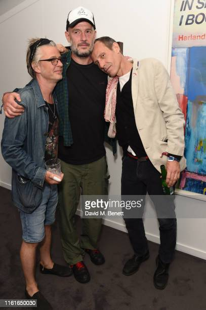 guest Jake Chapman and Marlon Richards attends the Teen Cancer America Suite at Bob Dylan and Neil Young in Hyde Park on July 12 2019 in London...