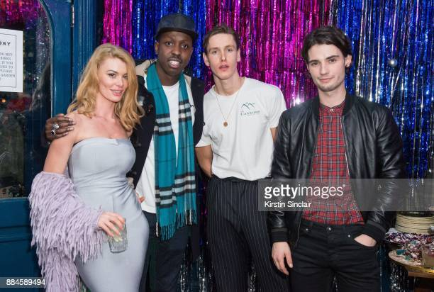 Guest Jamal Edwards Harris Dickinson Jack Brett Anderson attends the Burberry x Cara Delevingne Christmas Party on December 2 2017 in London England