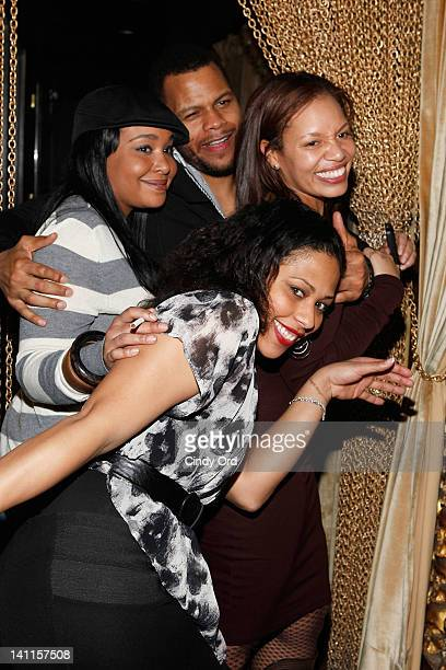 A guest Jenn Goldson Damien Alexander and Quinn Rhone attends Sylvia Rhone's surprise birthday party at Goldbar on March 11 2012 in New York City