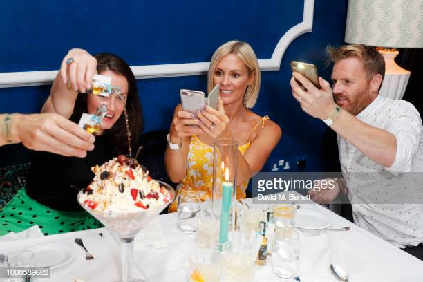 Guest Jenni Falconer and James Midgley attend Casamigos Tequila's Away for August private dinner at Bagatelle on July 31 2018 in London United Kingdom