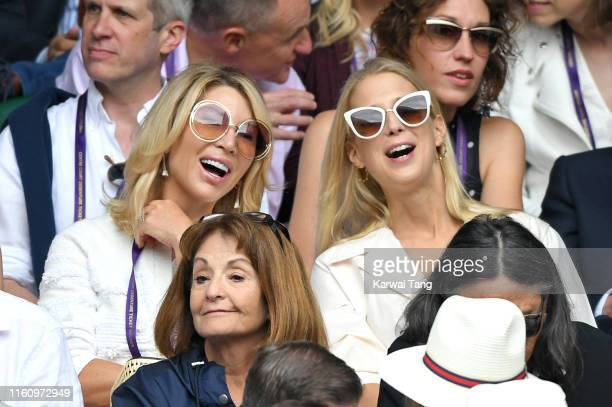 Guest joins Lady Gabrielle Windsor on Centre court during day eight of the Wimbledon Tennis Championships at All England Lawn Tennis and Croquet Club...