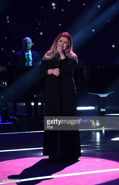 Guest judge and Season 1 winner Kelly Clarkson performs onstage at FOX's American Idol Season 15 on February 25 2016 in Hollywood California