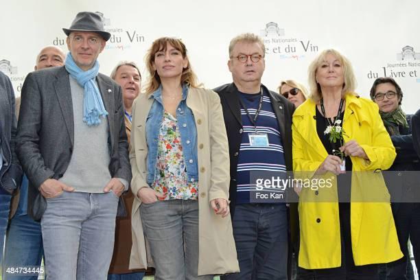 Guest, Julie Debazac, Dominique Besnehard and Mylene Demongeot attend the 'Journees Nationales du Livre et du Vin 2014' At Bouvet Ladurey Cellars on...