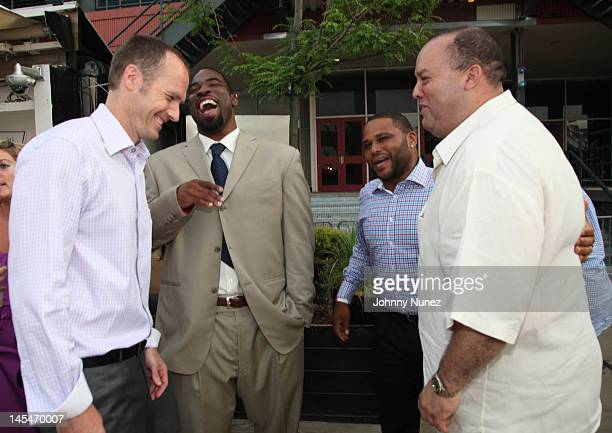 Guest Justin Tuck Anthony Anderson and Richard Selgado attend the NY Giants Justin Tuck VIP charity reception at the Beekman Beer Garden on May 30...
