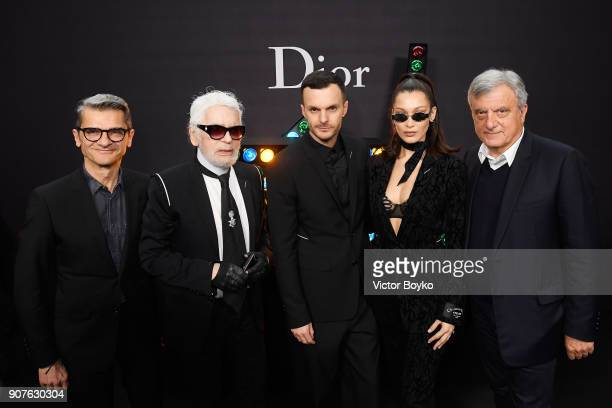 A guest Karl Lagerfeld Kris Van Assche Bella Hadid and Sidney Toledano pose backstage after Dior Homme Menswear Fall/Winter 20182019 show as part of...
