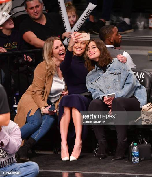 Guest, Karlie Kloss and Ashley Graham take a selfie as they attend Milwaukee Bucks v Brooklyn Nets game at Barclays Center on April 1, 2019 in New...