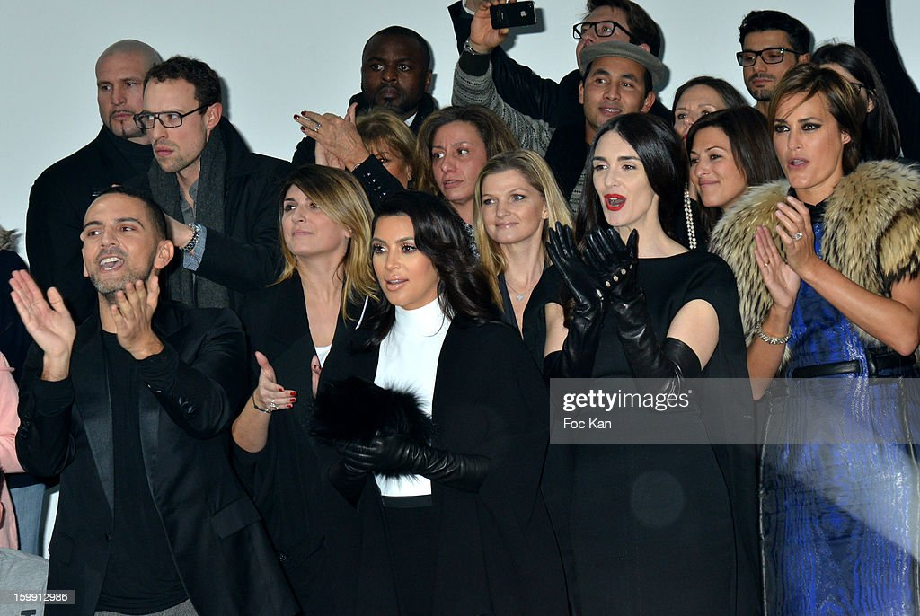 A guest, Kim Kardashian, Paz Vega and Yasmine Le Bon attend the Stephane Rolland Spring/Summer 2013 Haute-Couture show as part of Paris Fashion Week at Palais De Tokyo on January 22, 2013 in Paris, France.