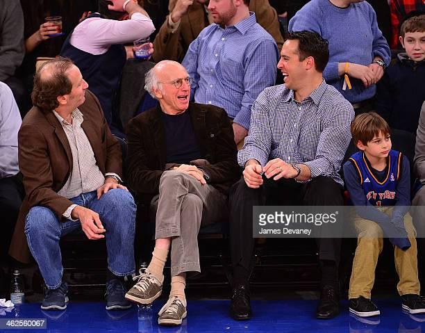 Guest Larry David Mark Teixeira and son attend the Phoenix Suns vs New York Knicks game at Madison Square Garden on January 13 2014 in New York City