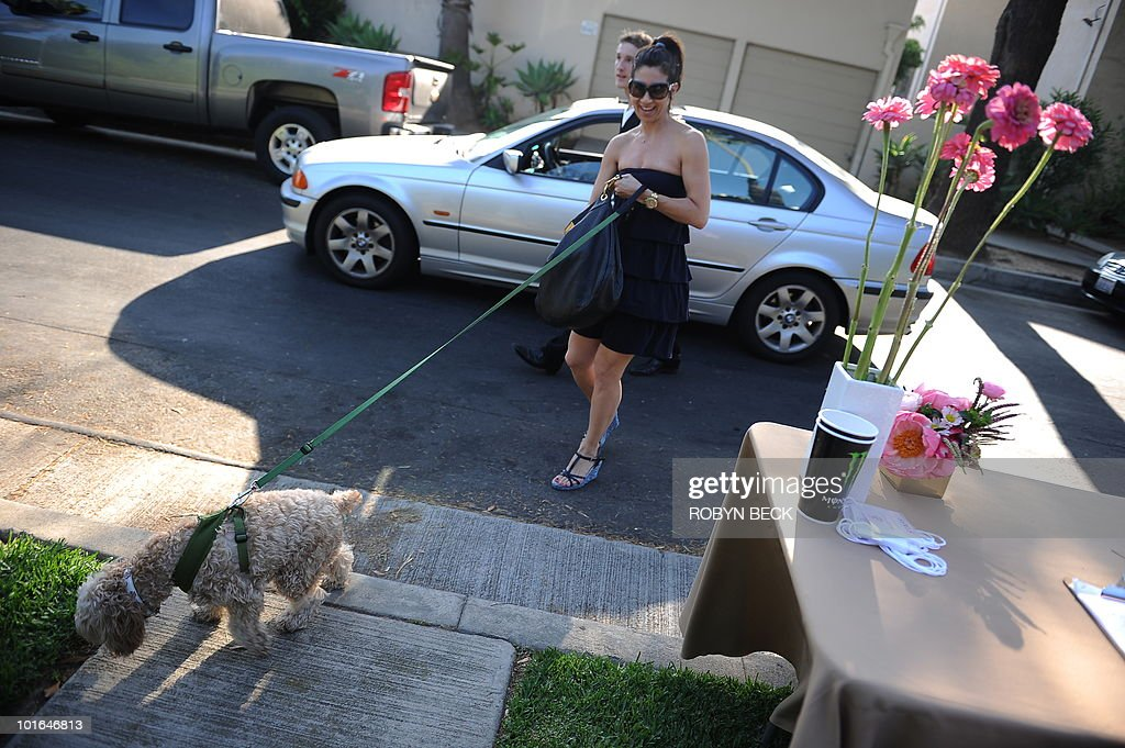 A guest leaves her car with the valet as she and her dog arrive at the Buddha Bark WonderPark luxury wellness suite on June 4, 2010 at Chaz Dean Studio & Zen Garden in Los Angeles. The Buddha Bark WonderPark luxury lounge event brings together celebrities and their dogs to introduce natural canine welless lifestyle solutions.