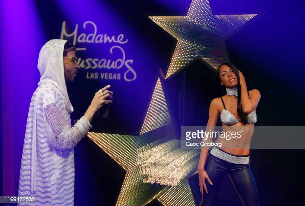 A guest live streams with a figure of RB Princess Aaliyah during an unveiling at Madame Tussauds Las Vegas at The Venetian Las Vegas on August 21...