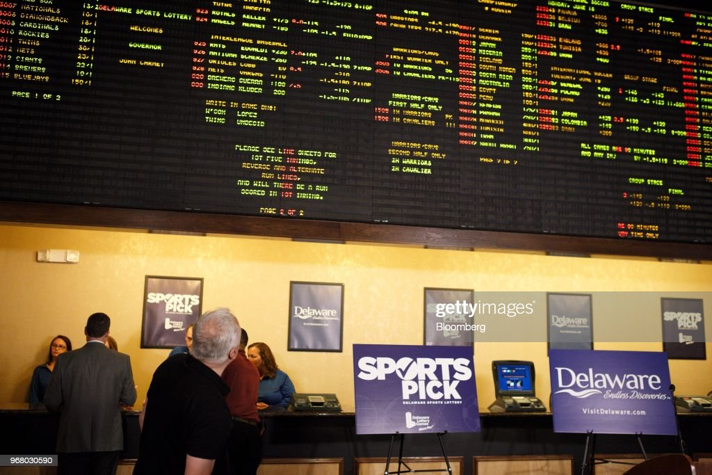 A guest looks at a gaming board during the launch of full-scale sports betting in Dover, Delaware, U.S., on Tuesday, June 5, 2018. Delawarebecame the first U.S. state aside from Nevada to allow wagers on individual professional sporting contests, just three weeks after the U.S. Supreme Court freed states to do so. Photographer: Michelle Gustafson/Bloomberg via Getty Images
