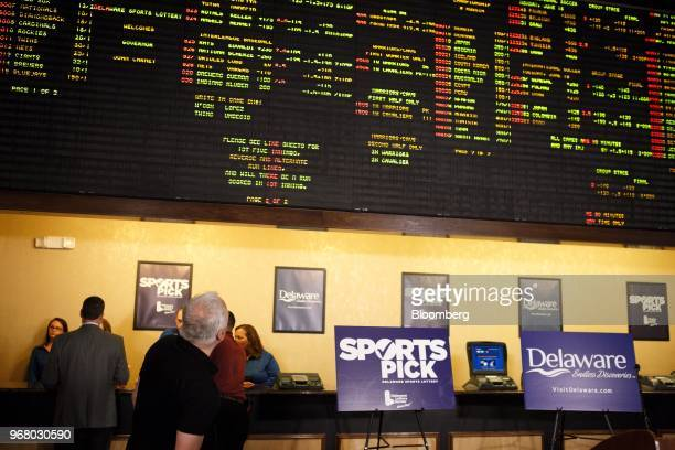 A guest looks at a gaming board during the launch of fullscale sports betting in Dover Delaware US on Tuesday June 5 2018 Delaware became the first...