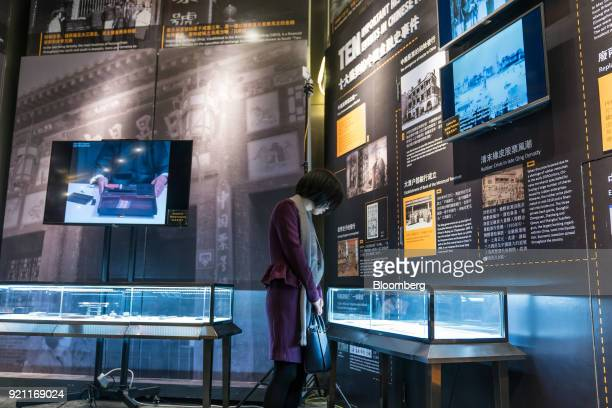 A guest looks at an exhibit at the Museum of Finance in the HKEX Connect Hall on the first day of trading after Lunar New Year at the Hong Kong...