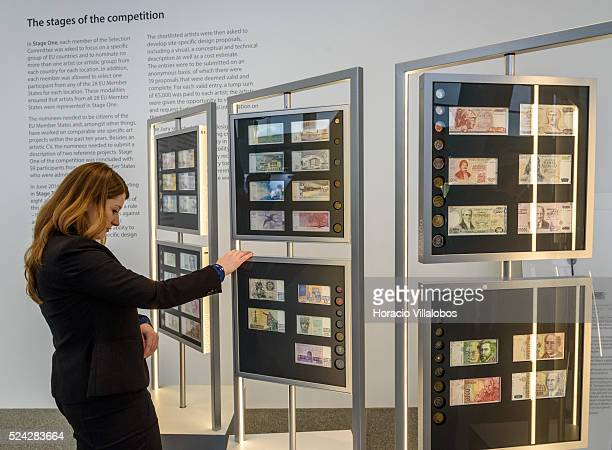 A guest looks at different banknotes exhibited at the official event hosted by the European Central Bank in Frankfurt Germany 24 November 2015 The...