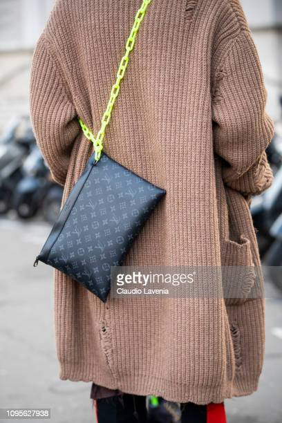 A guest Louis Vuitton bag details is seen in the streets of Paris before the Issey Miyake Men show on January 17 2019 in Paris France