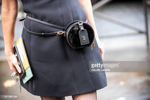 Guest, Louis Vuitton belt bag details, is seen outside the Miu Miu show during Paris Fashion Week - Womenswear Spring Summer 2020 on October 01, 2019...