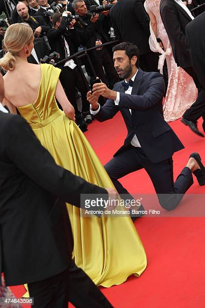 A guest makes a proposal at the closing ceremony and 'Le Glace Et Le Ciel' premiere during the 68th annual Cannes Film Festival on May 24 2015 in...