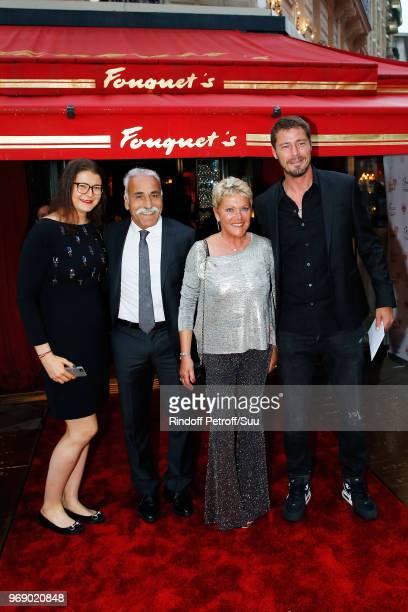 """Guest, Mansour Bahrami, Frederique Bahrami and Marat Safin attend """"Diner des Legendes"""" at Le Fouquet's on June 6, 2018 in Paris, France."""