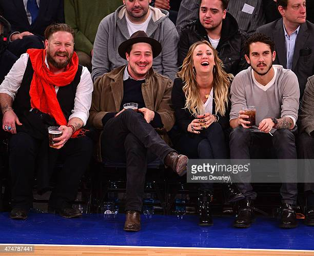 Guest Marcus Mumford Kaley Cuoco and Ryan Sweeting attend the Dallas Mavericks vs New York Knicks game at Madison Square Garden on February 24 2014...