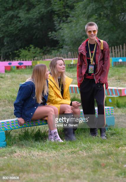 guest Margot Robbie Cara Delevingne attend day one of Glastonbury on June 23 2017 in Glastonbury England
