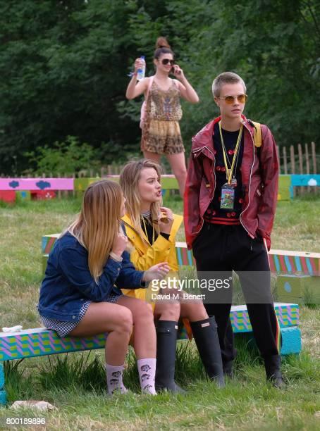 guest Margot Robbie Cara Delevingne attend day one of Glastonbury on June 23 2017 in Glastonbury England