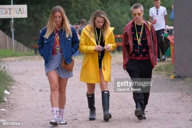 Guest, Margot Robbie, Cara Delevingne attend day one of Glastonbury on June 23, 2017 in Glastonbury, England.