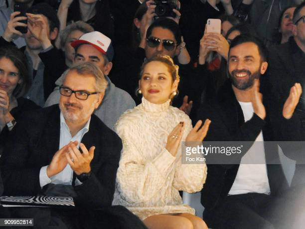 A guest Marion Cotillard and fashion designer Nicolas Ghesquieres attend the JeanPaul Gaultier Haute Couture Spring Summer 2018 show as part of Paris...
