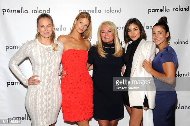 Guest Model Nadine Leopold designer Pamella Roland actress Olivia Culpo and Olympic gymnast Aly Raisman pose backstage for the Pamella Roland Spring...