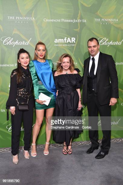 R A guest model Petra Nemcova Caroline Scheufele and Milutin Gatsby attend the amfAR Paris Dinner 2018 at The Peninsula Hotel on July 4 2018 in Paris...
