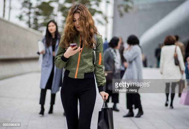 A guest model wearing bomber jacket is seen at the Hera Seoul Fashion Week 2018 F/W at Dongdaemun Design Plaza on March 20 2018 in Seoul South Korea