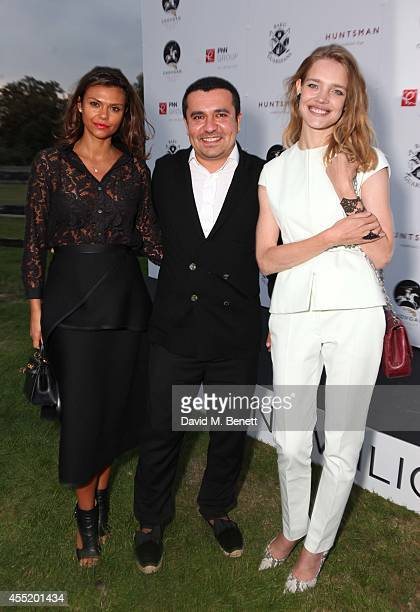 Guest Nasib Piriyev and Natalia Vodianova attend the Chovgan Twilight Polo at Ham Polo Club on September 10 2014 in Richmond England