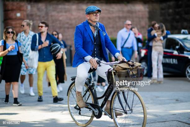 A guest on a bike is seen during the 94th Pitti Immagine Uomo on June 14 2018 in Florence Italy